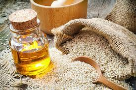 sesame oil in bottle and seeds